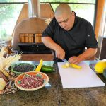 Chef Ray Naranjo preparing food for Intimate Indigenous Experience Indian Pueblo Kitchen