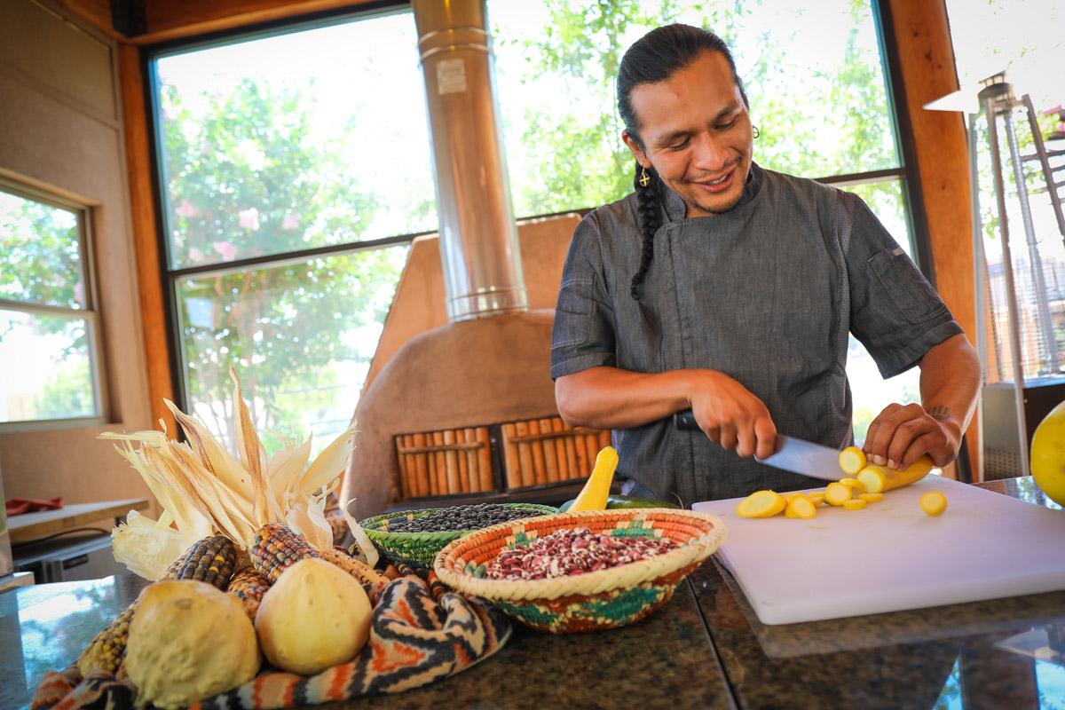 Chef Ben Shendo preparing food for Intimate Indigenous Experience Indian Pueblo Kitchen